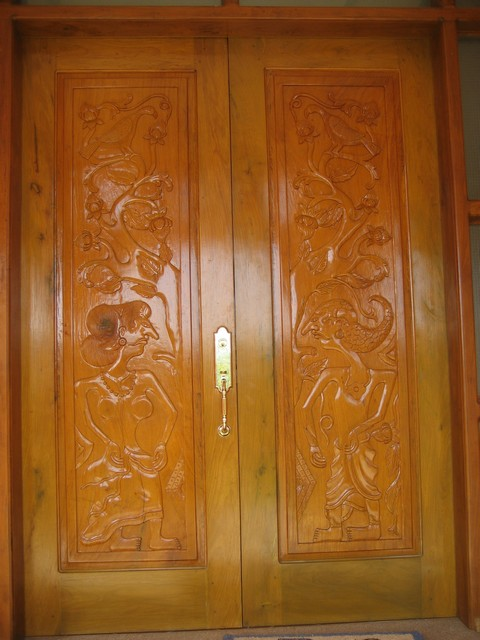 Front door carved in Balinese style