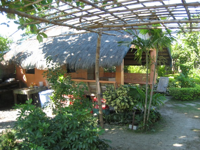 The two nipa huts are still a popular naptime destination